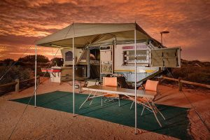 Setting with front awning, ground sheet, camping chairs and large camping table