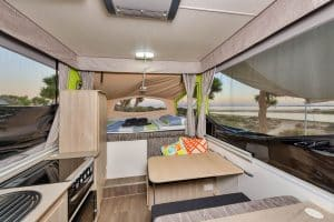 Spacious interior of our Jayco Swan Outback Hire Camper Trailer set up at Ningaloo Reef, Western Australia